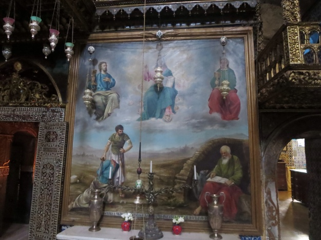 Painting of St James and St John on the right and left hand sides of Jesus in glory